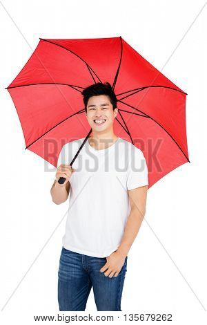 Happy young man holding a umbrella on white background