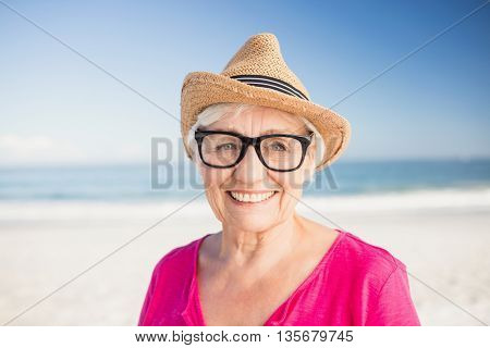 Happy senior woman smiling on the beach