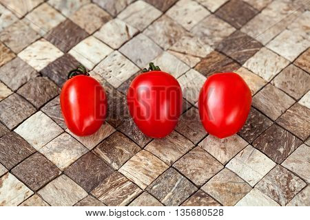 Two Cherry Tomatoes On Wooden Checkered Background
