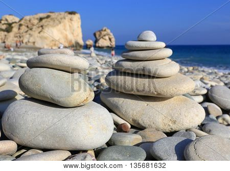 pyramid of balanced stones on sea in nice summer day