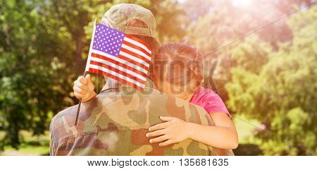 Rear view of army man hugging daughter with American flag while leaving from home