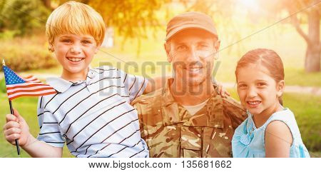 Portrait of smiling army Officer with children in park