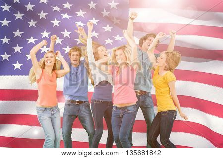 Friends partying together while laughing and smiling against close-up of american flag