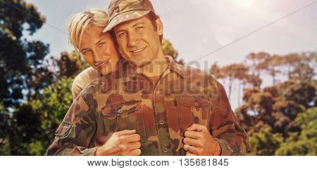Portrait of simling army man with wife in park