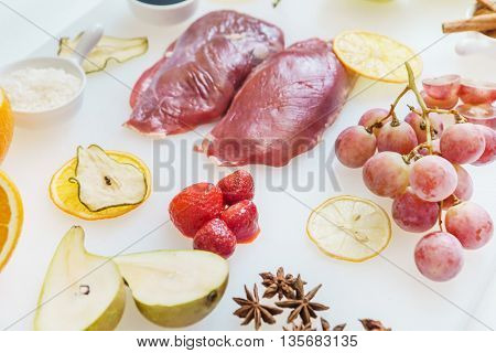 raw duck breast with fruits