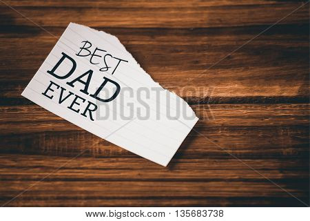 Best dad ever written on paper on wooden table