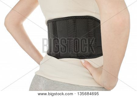 Female torso while wearing the therapeutic belt view from the back on a white background, isolate, horizontal
