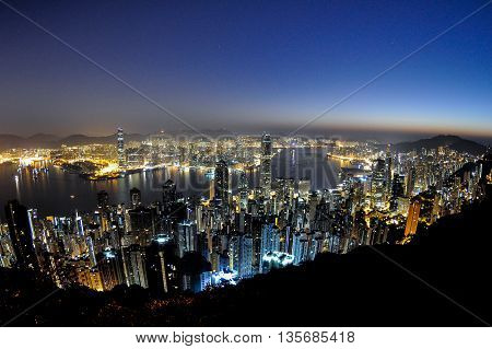 Night view of busy city at dawn.
