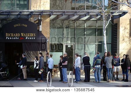 SAN DIEGO, UNITED STATES - DECEMBER 25: A crowd stands in line at the Richard Walker's Pancake House in downtown and on December 25, 2015 in San Diego.
