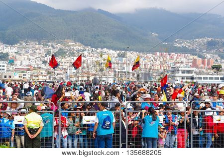QUITO, ECUADOR - JULY 7, 2015: Ecuador and Quito flags around the huge event of pope Francisco mass, thousand of people attends.