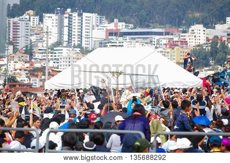 QUITO, ECUADOR - JULY 7, 2015: Pope Francisco making a little round trip around the big mass, lots of people. Mobile pope.