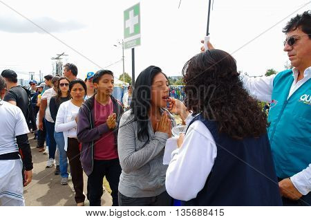 QUITO, ECUADOR - JULY 7, 2015: People make a line to receive the communion on pope Francisco mass on Ecuador.