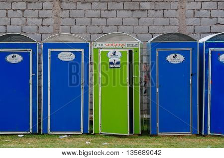 QUITO, ECUADOR - JULY 7, 2015: Eco portable toiletes in blue and green color, public events needs.