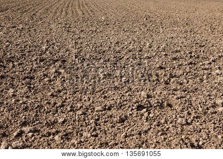 the farmer out in the field is plowed earth