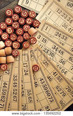 Vintage lotto: kegs and cards  on a wooden table