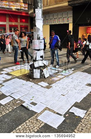 Sao Paulo Brazil - October 5: People reading job offers on an improvised advertising column on October 5 2014 in Sao Paulo Brazil. The unemployment rate in Brazil was 6.9 percent in December of 2015.