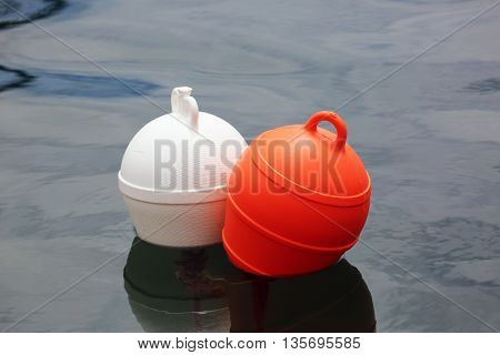 Orange And White Buoys in the Sea