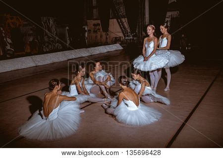 The seven ballerinas behind the scenes of the theater