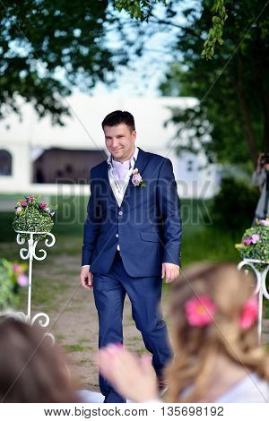 Handsome Groom In Suit On The Nature. Male Portrait In The Park. Beautiful Model Boy In Colorful Wed