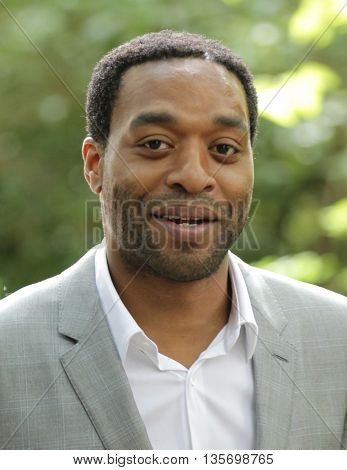 LONDON, UK, JUNE 15, 2015: Chiwetel Ejiofor attends the Burberry Prorsum fashion show London Collections picture taken from the street
