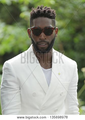 LONDON, UK, JUNE 15, 2015: Tinie Tempah attends the Burberry Prorsum fashion show image taken form the street