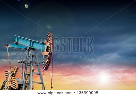 Oil Pump At Sunset.