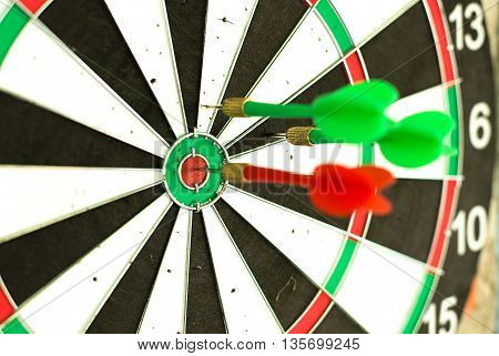 The dart is in the center of the target