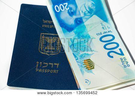Stack Of Israeli Money Bills Of 200 Shekel And Israeli Passport - Top View