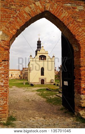 View of the church of St. Michael through the arch gate in Medzhybozh fortress