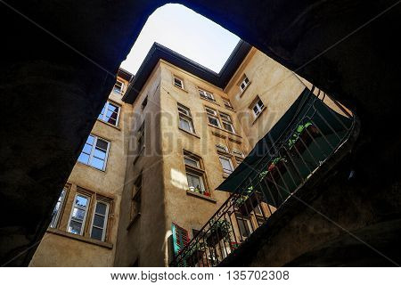LYON, FRANCE - MAY 24, 2015: Traboule is a pedestrian passage through the quarter allowing to get from one street to another. It's view of inside the traboule's yard.