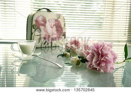 still life peony handbag and cup of milk