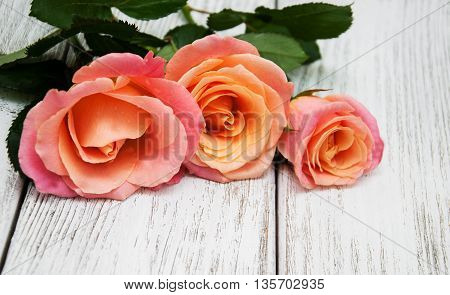 Pink Roses On A Wooden Background