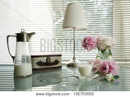 still life peony handbag and Antique jug and cup of milk