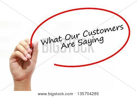 Man Hand writing What Our Customers Are Saying with marker on transparent wipe board. Business internet technology concept.