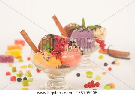 Fruit flavored ice cream with dry fruit, vanilla sticks and fresh currant