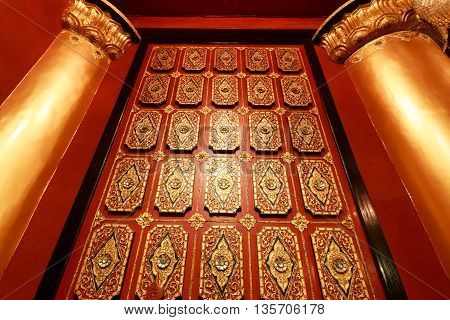 Wood Carving On The Pillar And Wall House In Myanmar. Myanmar House Carving On Golden Pillar And Wal