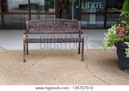 SHOREWOOD, ILLINOIS / UNITED STATES - AUGUST 30, 2015: People are welcomed to sit an a bench on the sidewalk of Shorewood's Apple Tree Plaza.