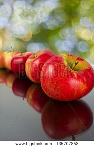 fresh and ripe apples on a dark background