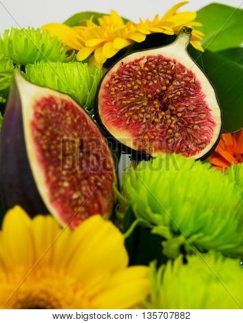 figs among the flowers. Sweet and juicy figs