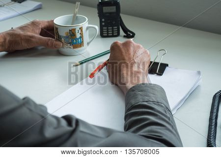 business office telephone and coffee in morning