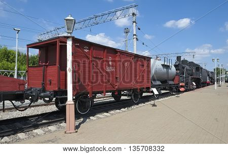 MOSCOW, RUSSIA - JUNE 23, 2016: Museum of Railway Transport of the Moscow railway two-axle freight wagon with brake platform