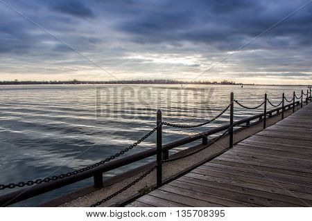 View on the lake from the dock, sunrays cross the sky. HDR photo