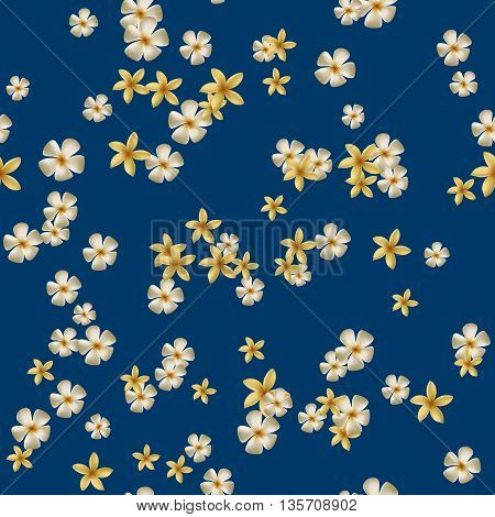 Seamless pattern with yellow plumeria on dark blue backgound.