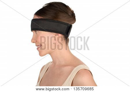 Sport's beauty - close-up of a woman silhouette wearing medical sport hair band isolated on white background