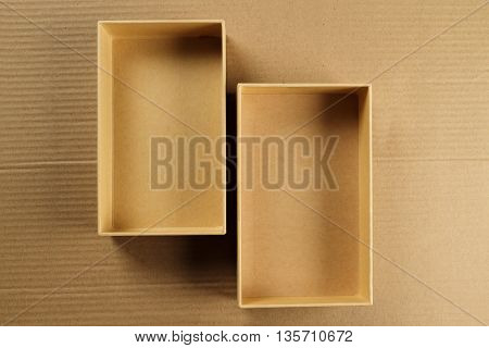 Open Recycled CardBoard Box on Corrugated Background