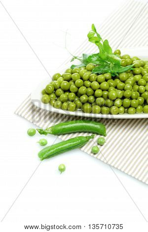 Plate Tasty Green peas on white background
