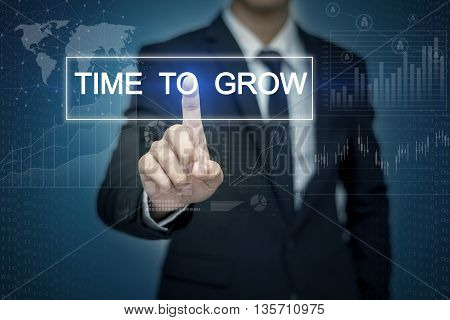 Businessman hand touching TIME TO GROW button on virtual screen