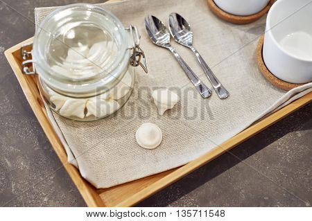 The meringues in glass jar on tray