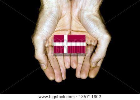 Flag Of Denmark In Hands On Black Background