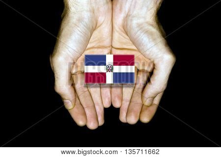 Flag Of Dominican Republic In Hands On Black Background